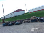 pic 8 of 12 -- 5 set up in a row - 5 by 7 at $250 each - all taken out and stacked on pallets in groups of 5